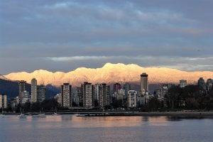 Vancouver Buildings With Mountains In Background | Ng Sidhu Law