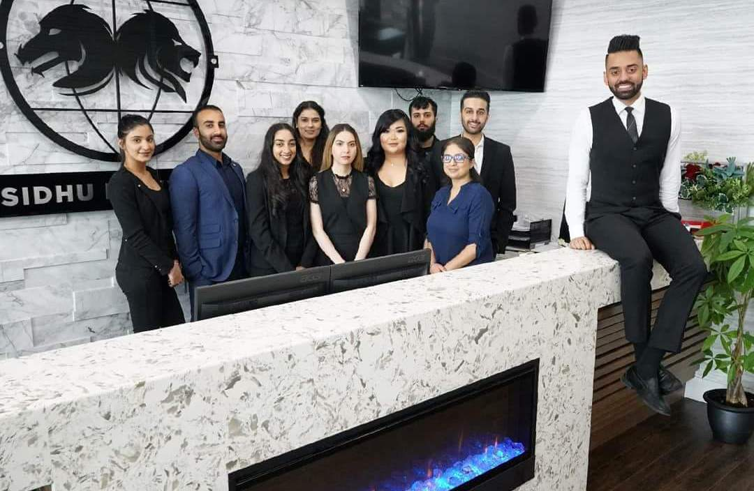 Shawn Sidhu and employees